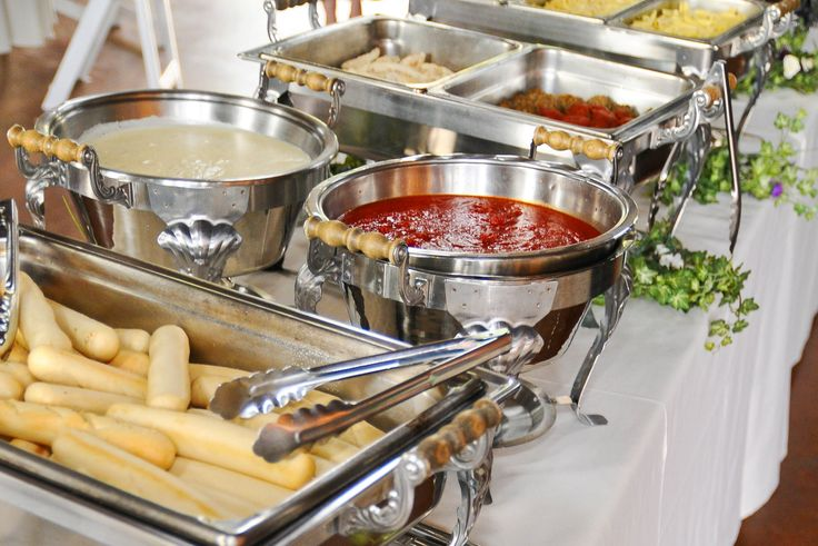 Pasta is a must for me at my wedding, I think this is a great idea. Offer pasta, two different sauces, toppings (like meatballs and chicken) and bread stick!