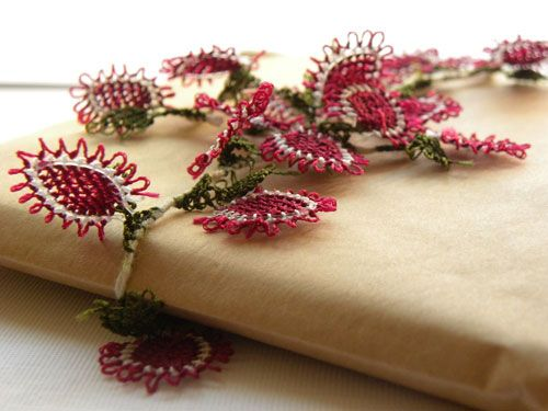 """Oya Turkish Lace Embellishments: The simple but chic brown paper wrap is adorned with """"oya"""", also known as Turkish lace, the history of which is thought to date back as far as the 8th century B.C. to the Phrygians of Anatolia. So lovely and intricate."""