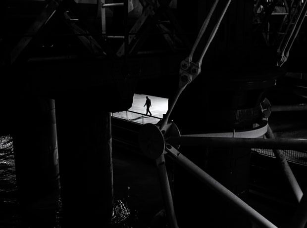 Photographer uses light and shadows to frame human forms in the city black white photographystreet photographyfine art
