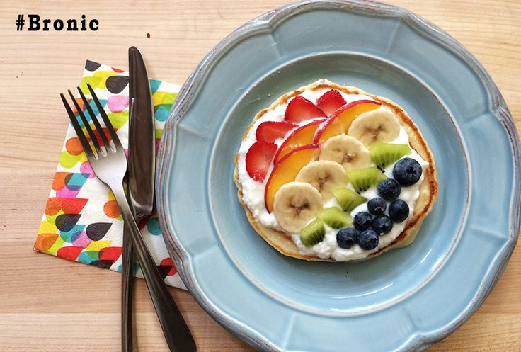 Rainbow Pizza Pancakes. If a plate of pancakes is your kid's dream breakfast, then try this fun, healthy spin on your classic flapjack. Thanks to the Greek yogurt and myriad of fruit, your kids will get the proper protein and nutrients for a full day of school and fun. #breakfast #pancakes #pizza #kid #food #fruit #bronic