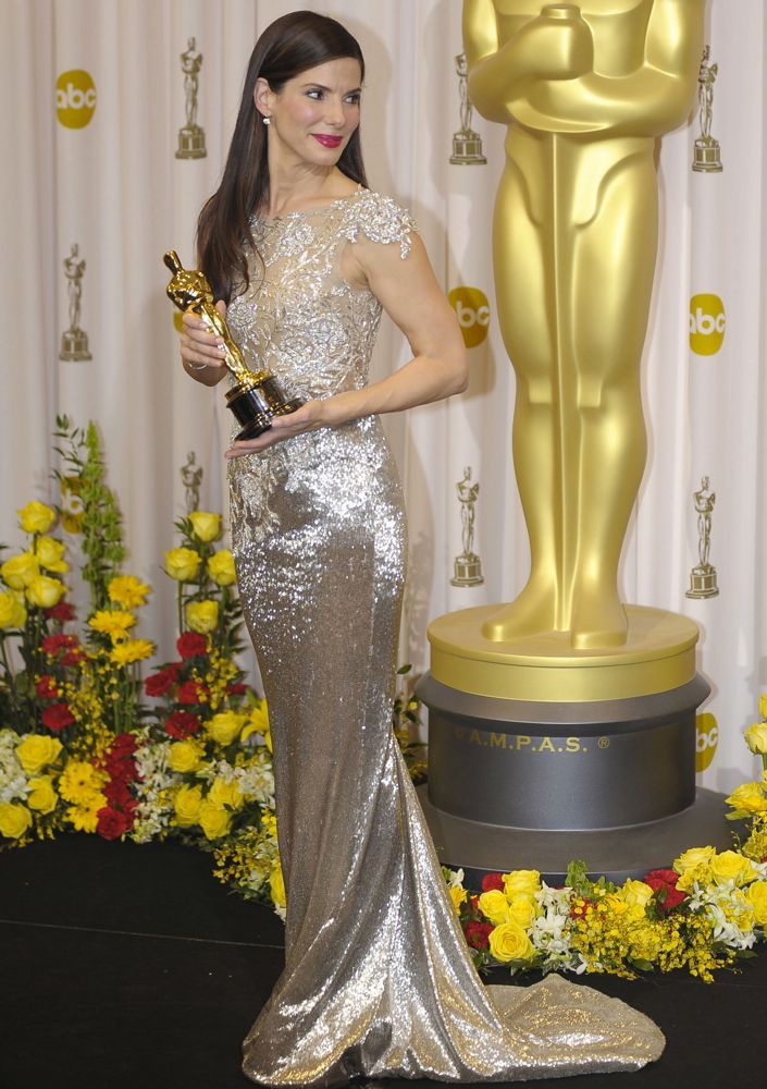 The only thing that could compete with Sandra's ornate Marchesa gown was an Oscar statue.Image: WENN.com