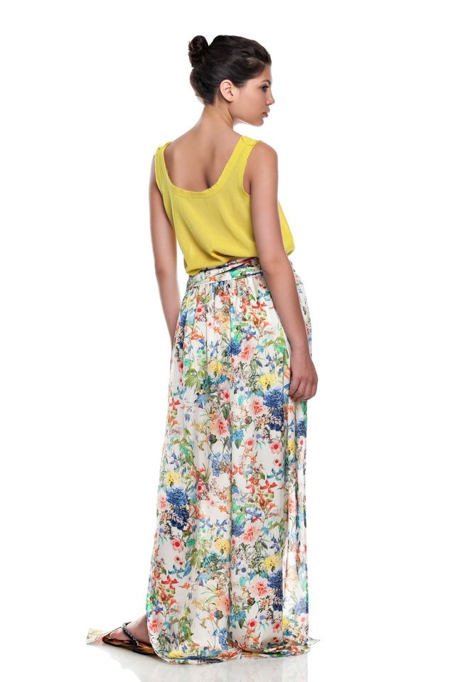 Yellow top and floral long skirt .