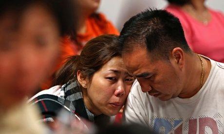 Family of passengers on board AirAsia flight QZ8501 at Juanda international airport, Surabaya
