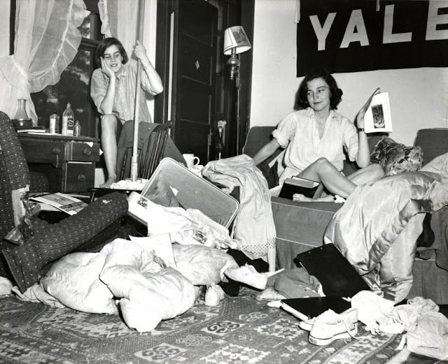 Students contemplate cleaning a messy dorm room, 1951.