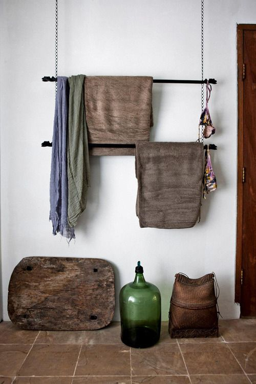 i kinda love the idea of hanging sticks for towel racks...or textile displays of course