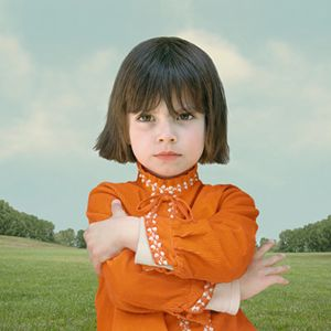 """Girl With Crossed Arms"" or ""Dorothea"" by Loretta Lux."