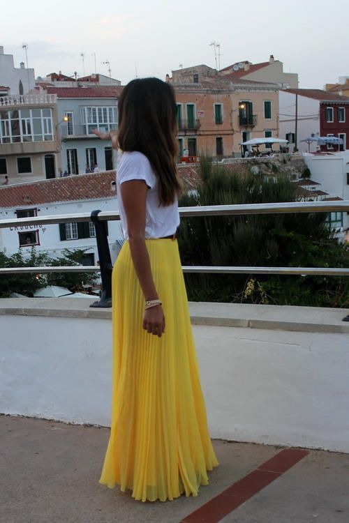 Yellow maxi skirt with white crope top.