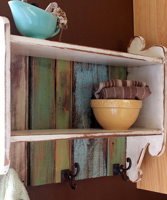 Find some old shelves at the DI and refinish with old wood backing.  Pod?