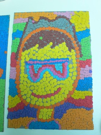 A picture made with dots of plasticine.