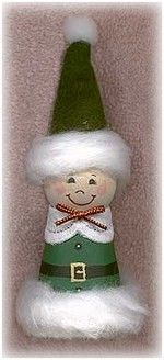 Make a cute clay pot elf ornament from Christmas, from a clay pot painted green and a wooden ball with doll features.