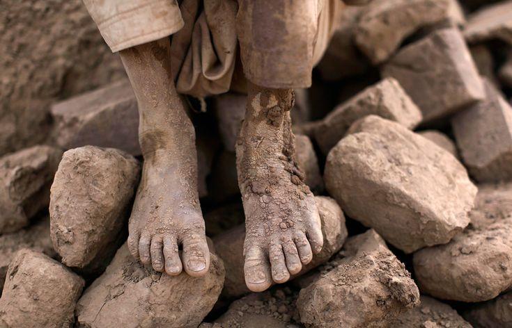 Pakistani Jaafar Sakhawat, 8, who works in a brick factory, takes a break on a pile of damaged bricks, on the outskirts of Islamabad, May 9, 2012. (Muhammed Muheisen/Associated Press): Broken Bricks, Dirty Feet, Bricks Factories, Pakistani Boys, Damaged Bricks, Sakhawat Pakistani, Favorit Photo, Jaafar Sakhawat, Pakistani Jaafar