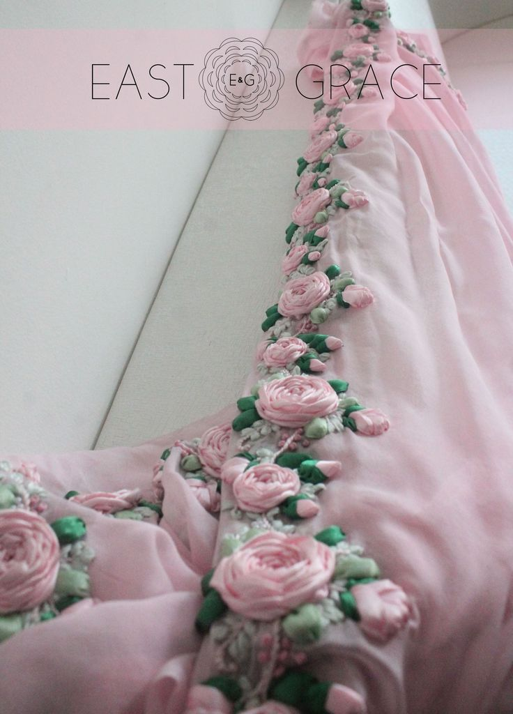 Pink Rose - This ethereal frosted baby #pink #chiffon #saree is adorned with roses on vines along the edges, crafted painstakingly with shades of pink satin #ribbon and sprinkled with glistening #pearls. #inspirationalquotes #eastandgrace E&G is coming soon at www.eastandgrace.com. Find us on Facebook: https://www.facebook.com/eastandgrace