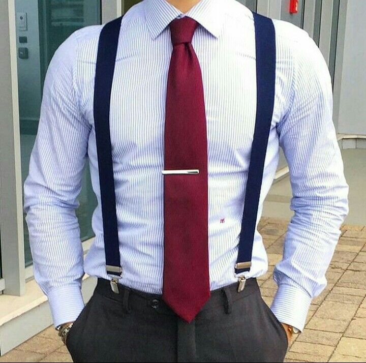 navy suspenders and red tie