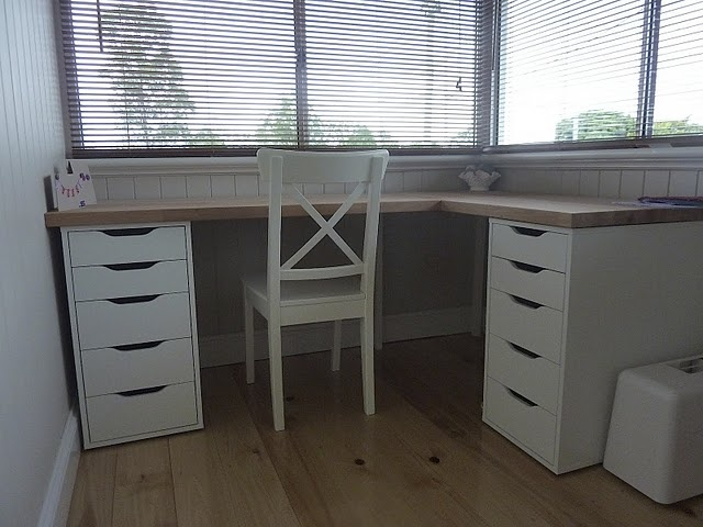 Simple functioning desk - I would just swap out one side of drawers for a file cabinet and put in the corner near the window of the study.
