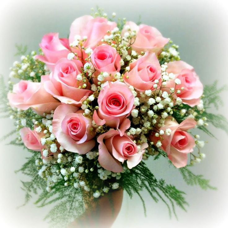 A classic bridal bouquet with pink roses and baby's breath. Very romantic and feminine! Created by our florists at our Grower Direct store in Thunder Bay, ON. #wedding #flowers