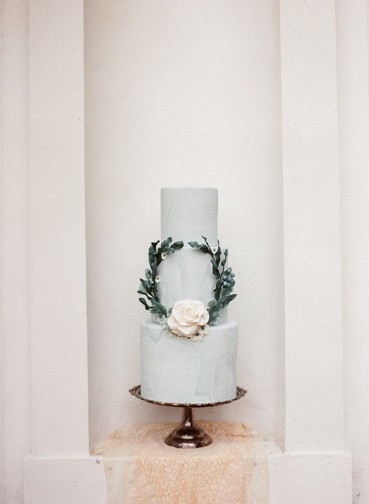 Dusty blue fine art wedding cake with wreath and flower by Le Petit Sweet. Photography by Ashley McCormick.
