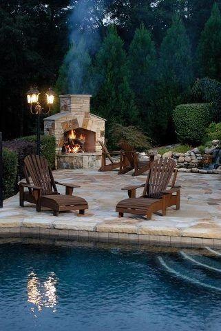 The ultimate backyard combo...deck / fireplace / pool