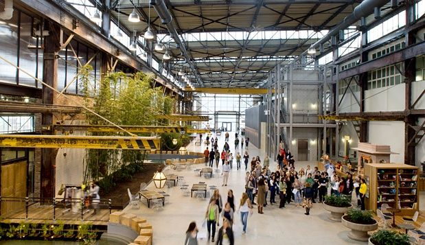 This award-winning adaptive reuse project was built on the site of an abandoned Pennsylvania Navy Yard. Urban Outfitters's founder, Dick Hayne, bought four hulking decommissioned and dilapidated buildings, near the Delaware and Schuylkill Rivers, and sunk $100 million into transforming them into a corporate headquarters that would reflect the buildings' industrial roots.