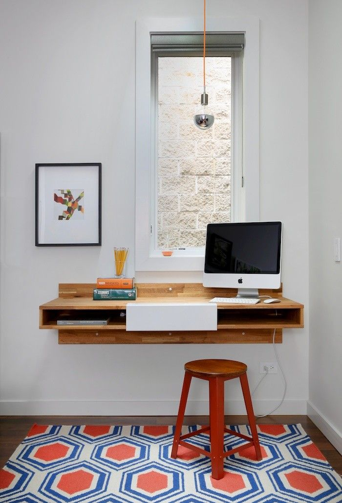 a mash studio wallmounted desk offers a place to study the rug is from one kingu0027s lane and a soco modern socket pendant illuminates the room