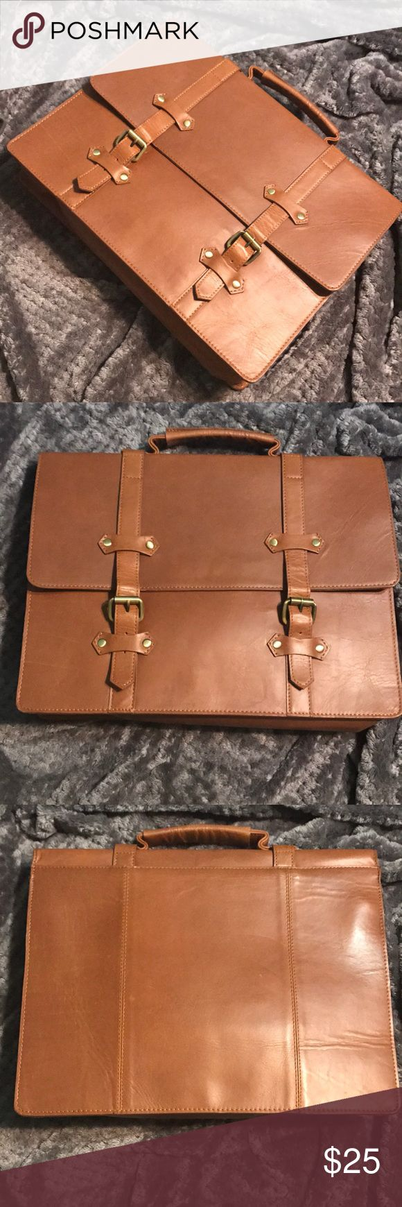 Ladies 💯% leather satchel in caramel brown tan A gently used leather satchel from ASOS. Very sturdy and durable. A Great vintage item that can be used for school. It has hooks on the sides so that you can attach a strap. ASOS Bags Satchels