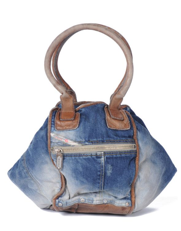 UPDATE: Purchase current and prior Diesel bags here and here. Most of the handbags in our personal collection are either made of leather or exotic materials but every now and then we spot a non-leather, non-exotic bag that meets our 'haute handbag for Fall' criteria. The Diesel Divina bag is one of those bags – …