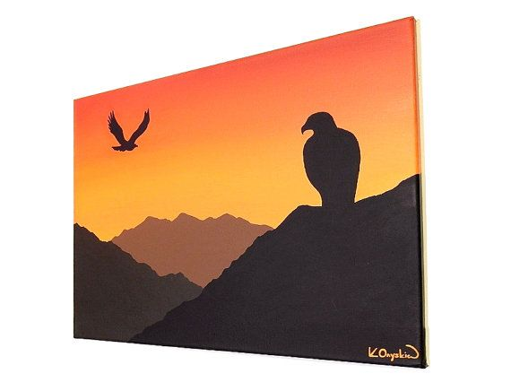 Painting of a mountain landscape with the silhouette of eagles against an orange sunset sky. By Kim Onyskiw.