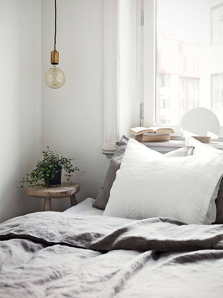 Using a small stool as a nightstand in the bedroom | Stadshem