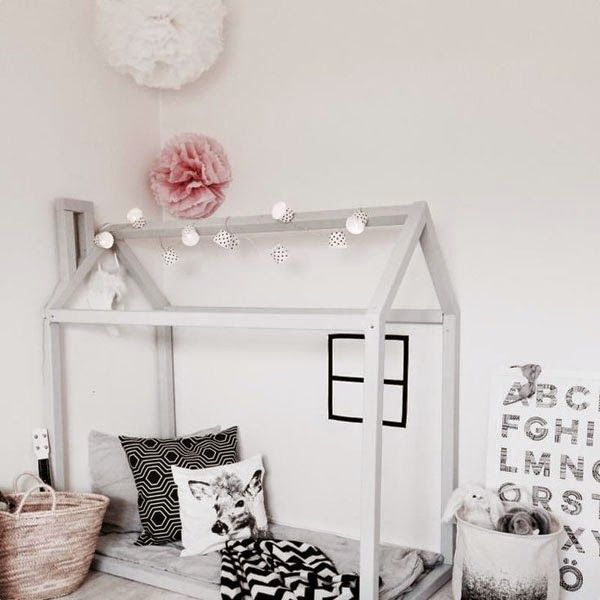 Kids love making dens so this is an idea that would really appeal to them and also looks super cute. A few touches of pink colour an otherwise monochrome scheme. #monochromekidsrooms #blackandwhitenursery