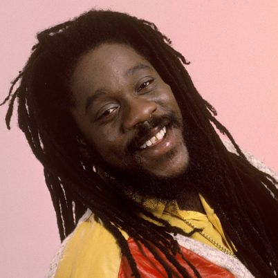 """Dennis Brown was born in Kingston, Jamaica in 1957. Hailed as a child prodigy and called the """"Michael Jackson of reggae,"""" Brown was just 12 years old when he recorded his first album, No Man is an Island, which included the hit single of the same name. Largely hailed as """"reggae's king"""" following Bob Marley's death in 1981, Brown recorded nearly 80 albums over his 30-year career. His addiction to cocaine contributed to his early death on July 1, 1999."""