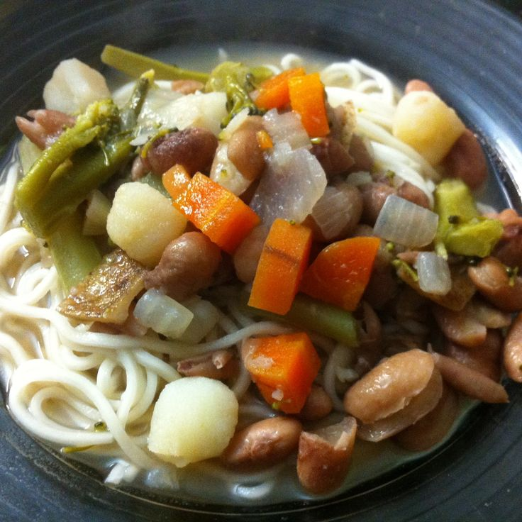 Beautiful combination of borlotti beans and vegetable soup topped on Asian Noodles!