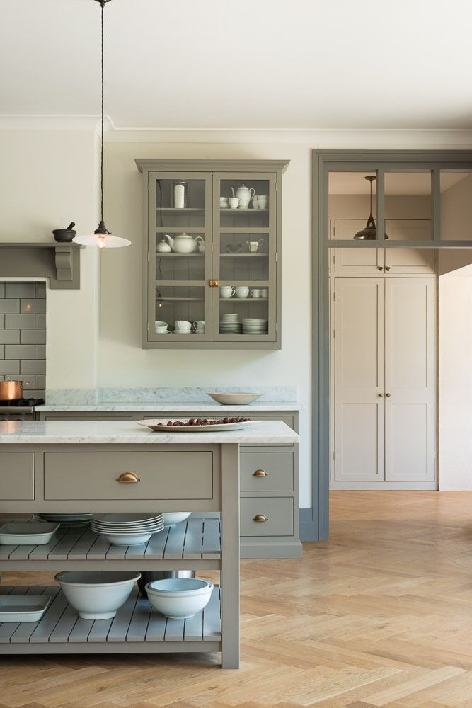 A Gl Front Cabinet Artfully Displays Ceramics In Kitchen Queens Park London Photograph Courtesy Of Devol
