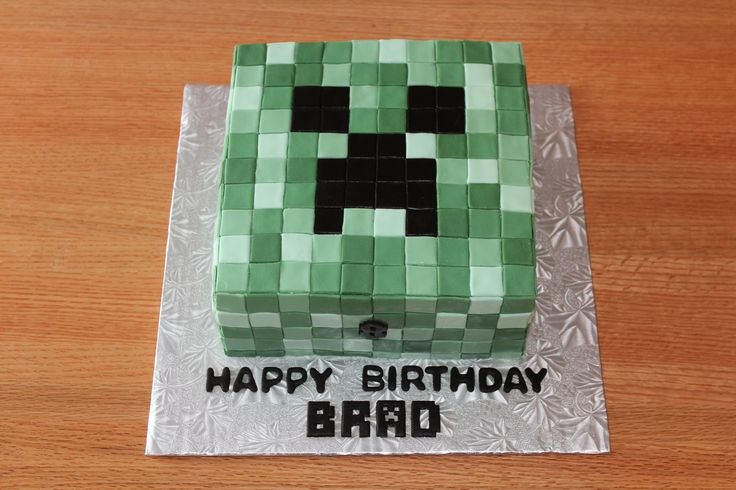 """Minecraft creeper cake - A Minecraft creeper cake for an 8-year-old - 9"""" square chocolate cake with BC and fondant squares."""
