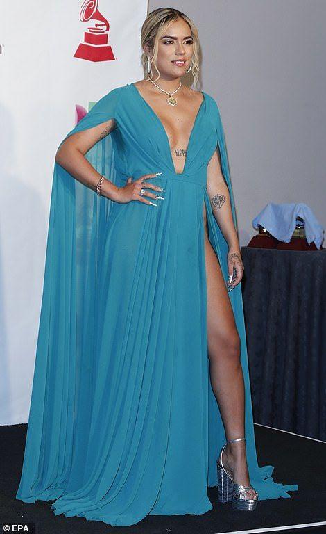 4098b4b034f9 Feeling blue: Karol G, real name Carolina Giraldo Navarro, stunned in a  long blue dress wi.