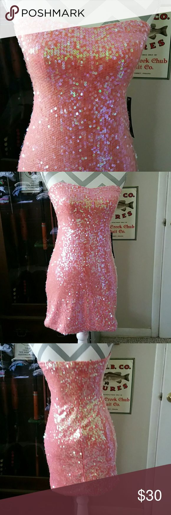 MEOW! Coral Strapless Dress w/ Iridescent Sequins This is such a gorgeous dress! Great for clubs, girls night out, parties... or just feeling sexy! This is NWT, fully lined, has great elastic for hold around the bust, sweetheart neckline, and my favorite part- covered in iridescent sequins! NWT. As U Wish Dresses Strapless