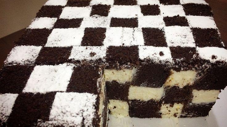 """Astăzi vă propunem să încercați o rețetă de cheesecake mai deosebit, sub formă de tablă de șah, care va atrage toate privirile și va fi apreciat la maxim. Prepararea acestui desert frumos o să vă aducă plăcere estetică și bună dispoziție. Cheesecake-ul de ciocolată """"Șah"""" este incredibil de gustos, foarte delicat și aromat, are un aspect deosebit de frumos și nu necesită mult timp de preparare. Toți oaspeții vor fi încântați de acest desert nemaipomenit și vor dori să afle secretul…"""