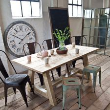 Loving the chairs, the table, the floor, the stools, the clock and those windows in the back.