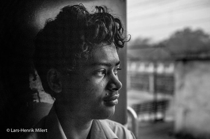 The young train-attendant. Traveling by train in India you meet these young guys working as attendants sleeping when the schedule allows on a small wooden cot hanging from the wall often with the neighboring door wide open. Canon EOS 5 mkIII EF 24-70@45mm 1/1500 f/40 Iso 6400