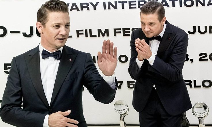 Tuxedo-clad Jeremy Renner accepts awards at Karlovy Vary Film Festival