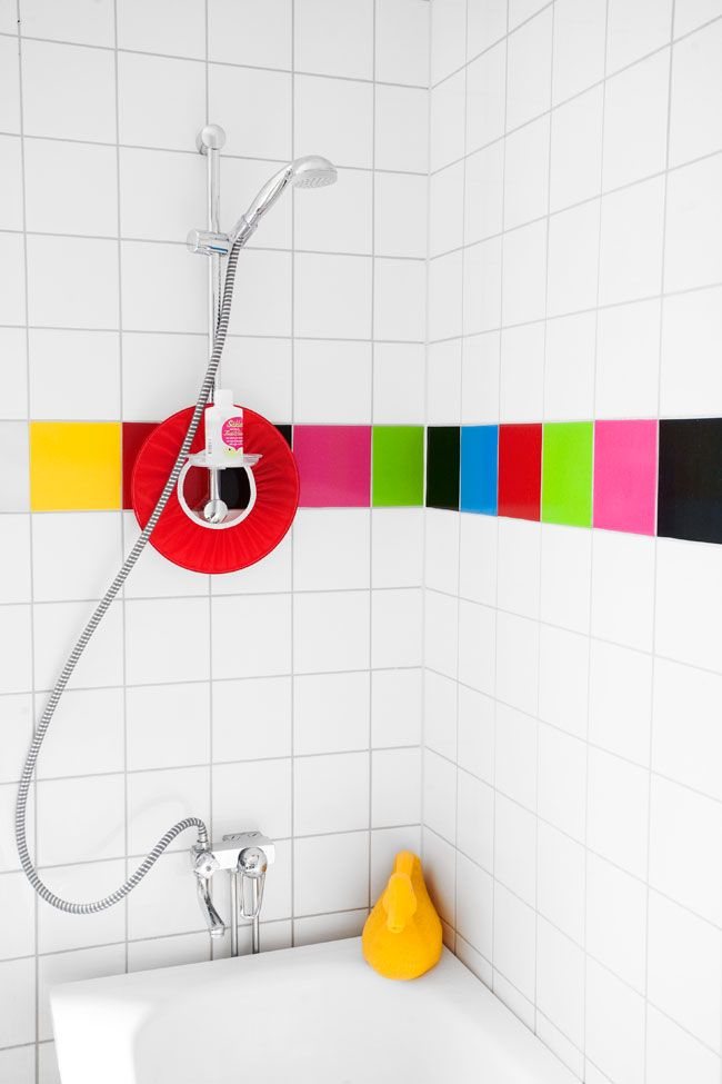 colorful tiles brighten up a white bathroom!