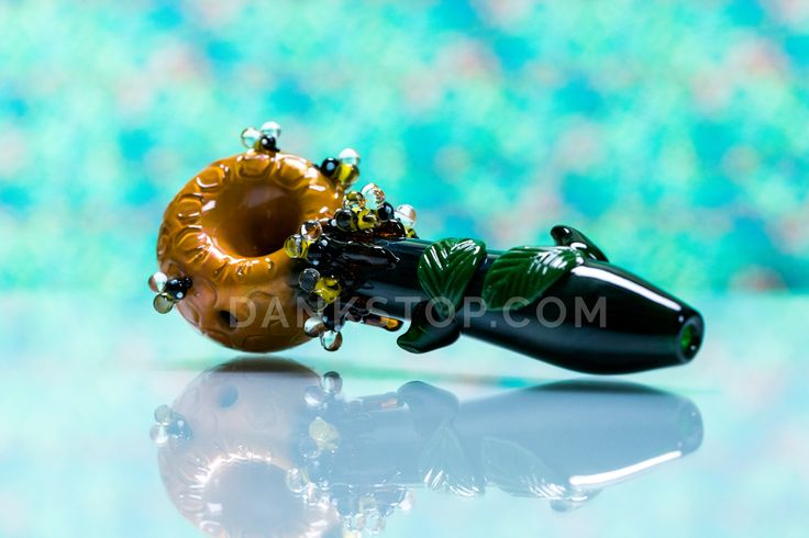 """""""Honeypot"""", bee-themed hand pipe by Empire Glassworks."""