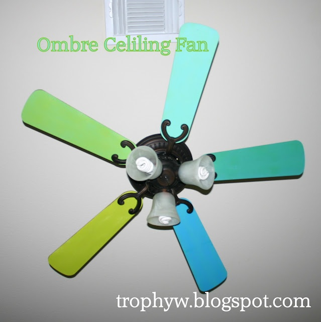diy... paint your ceiling fan. ( I just painted my fan white ceiling fan blades lime green! It goes great with my decor! It really looks great in my bedroom!)