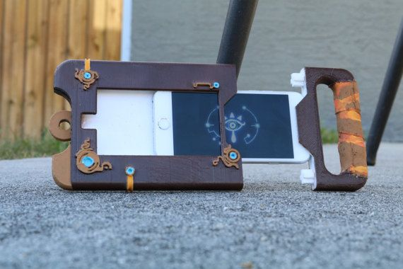 Thank you to SoulEaterGaming for making this 3d model for me! There is also a non-phone case version of this on my shop, check it out! Is currently designed to fit iphone 6 and 6s but can be modified to fit any phone, so just ask! This is a full scale, entirely 3d printed version of the Sheikah Slate from the hot new upcoming game Legend of Zelda: Breath of the Wild and its purpose in the game is the map that guides you throught the world as well as several still unknown powers. Perfect for…