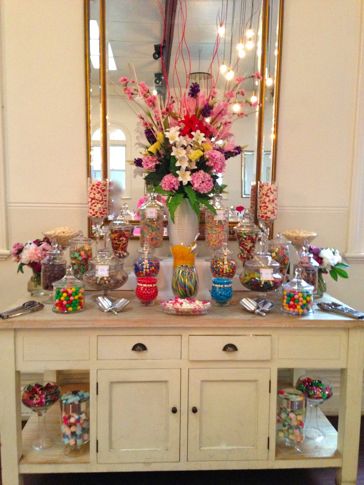 """Ooh La La Lolly Bars & Candy Buffet's created a very colourful candy buffet for a wedding where the bride requested that the candy bar """"does not blend in but instead stands out""""."""