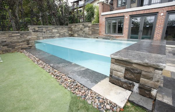 This Very Unique Pool Has A 2 X 23 Tempered Glass Spill Wall With The Flow Collecting In A