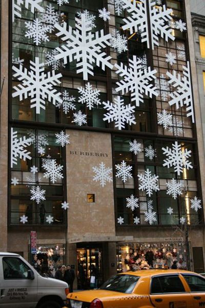 giant paper snowflakes in window, I love NYC