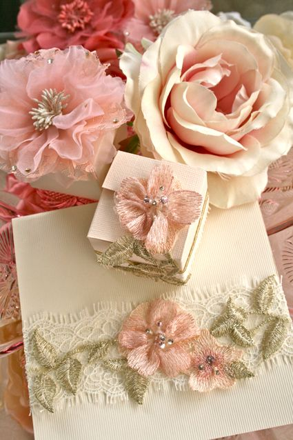 use crochet roses Pink petaled flowers on perfectly wrapped favor boxes.