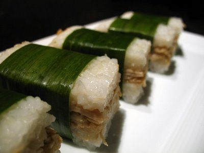 Lemper ayam. Glutinous rice with chicken filling, wrapped in banana leaves.