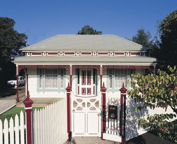 This traditional Victorian home is a classic example of a house built during the reign of Queen Victoria (1837–1901). Its warm, exterior colours work well with the surrounding bushland environment. Colours are by Dulux; Jade Blue, Indian Red and Whisper White