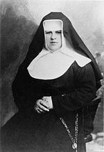 "Sister Maria Restituta was a nun and a nurse.  She refused to take down crucifixes, due to the effects of Anschluss. This and two of her writings that were critical of the régime would lead to her doom. She was denounced by a doctor who supported the Nazis, and she was arrested by the Gestapo right after coming out of the operating theatre. On 29 October 1942 she was sentenced to death by the guillotine by the Volksgerichtshof for ""favouring the enemy and conspiracy to commit high treason""."