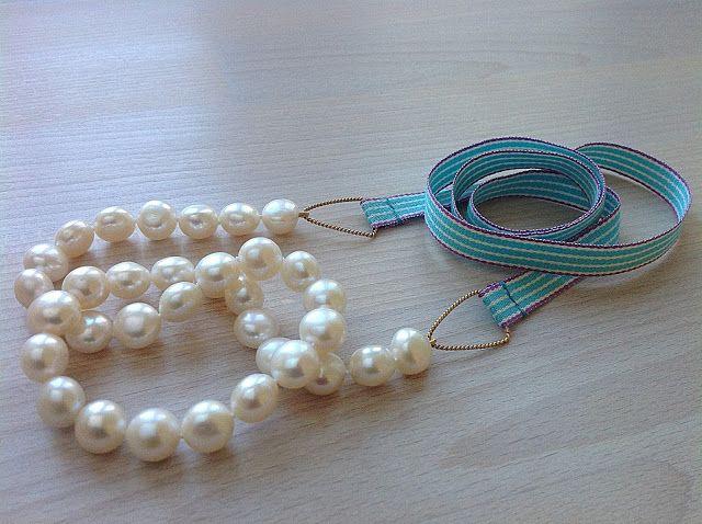 Bellas bedrifter: Nyt bånd på perlekæden med de store hvide perler...